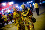 Uighur women make their way through night market in Yarkand, Xinjiang province in China, August, 2010.
