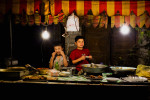 Uighur children sell food at night market in Yarkand, Xinjiang province in China, August, 2010.