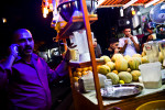 Men gather around a juice stand in Karadah district, Baghdad in Iraq, November, 2010.