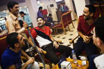 "Men enjoy each other's company at hukkah cafe in Karadah district, Baghdad in Iraq, November, 2010.  ""No one can stop us from loving Baghdad at night,"" said Haidar Abu Fatma, 39, ""No one will stop us from living."""