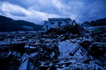 Snow falls on rubbles of tsunami devastated Rikuzentakata, Iwate prefecture, Japan, 2011.