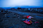 Two dead bodies are left covered by futon in rubbles of tsunami devastated Rikuzenmaeda, Iwate prefecture, Japan, 2011.