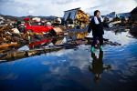 Chieko Chiba looks for remains of her house in tsunami devastated Kesennuma, Miyagi prefecture, Japan, 2011.