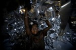 Zihadul Islam, 12,  works at an aluminum factory in Dhaka, Bangladesh. He works 8 hours a day 6 days a week and earns 1000tks (about US$14) a month.