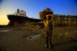 Paval, 10,  cutter helper, works at a ship breaking yard in Chittagong, Bangladesh. He makes about 10tks per/hour. (1USD=70tks)