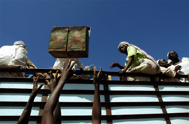 Villagers from Tama load the remains of their belongings onto a truck to take them off to where they have fled at Uma Kasara village almost two weeks after Tama was attacked, and around 40 people were killed by Arab Nomads backed by government forces North of Nyala, November 2005.  The AU made several attempts at patrolling and conducting an investigation on the village of Tama after it was attacked, and the surviving villagers fled to a nearby village, and was kept away by nomads who continued to surround the village and shoot at approaching vehicles.  Hundreds of villages have been burned and pillaged throughout Darfur by Arab Nomads, leaving hundreds of thousands of civilians displaced throughout the country.