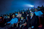 Iraqis watch a 3-D movie in Baghdad, February 2010.