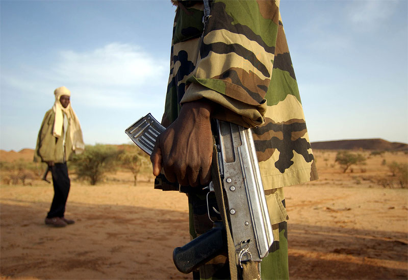Soldiers with the police division of the Sudanese Liberation Army train at a base in Shigekaro, Darfur, Sudan,  August  2004.  The SLA is one of several of Sudanese rebel groups controlling parts of Darfur.