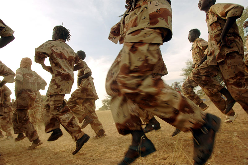 Rebels with the Sudanese Liberation Army train at dawn while attending a large rebel conference in Haskanita, in SLA territory in Darfur, Sudan, October 2005.  As fighting continues throughout darfur between Arab nomads  backed by government forces and ethnic Africans led by SLA fighters and other rebel groups, hundreds of thousands of Darfurians have been displaces, and thousands killed in fighting.
