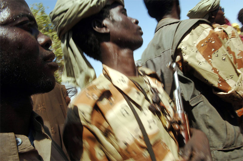 Rebels with the Sudanese Liberation Army attend a large rebel conference in Haskanita, in SLA territory in Darfur, Sudan, October 2005.  As fighting continues throughout darfur between Arab nomads  backed by government forces and ethnic Africans led by SLA fighters and other rebel groups, hundreds of thousands of Darfurians have been displaced, and thousands killed in fighting.