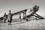 Boys play around a destroyed plane left over from the Soviet-Afghan Warin Kabul, Afghanistan, May 2000.
