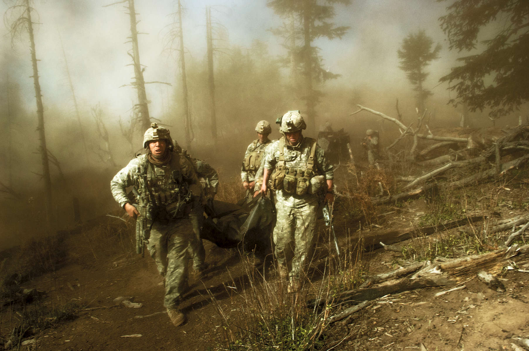 US troops carry the body of Staff Sergeant Larry Rougle, who was killed when Talibaninsurgents ambushed their squad in the Korengal Valley, Afghanistan, October 2007.