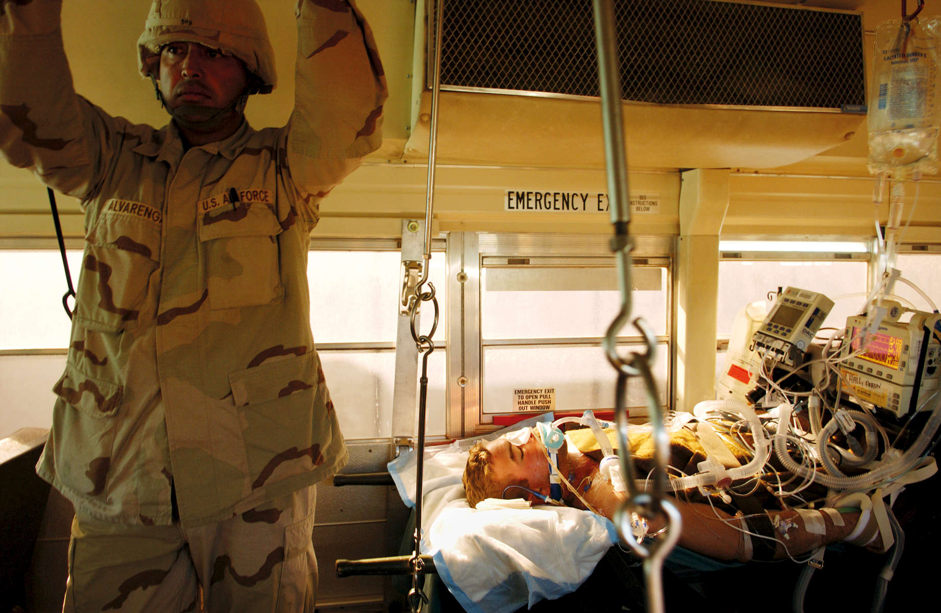 US Marines wounded in the Battle of Fallujah are treated by Navy doctors and preparedfor evacuation to Germany at the Balad Military Hospital, Iraq, November 2004.