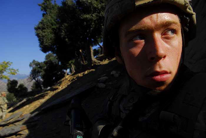 PFC Garrett Clary, 20, with the first platoon of the 173rd battle company on patrol in a village near Vegas base in the korengal valley. Afghanistan, October 2007.
