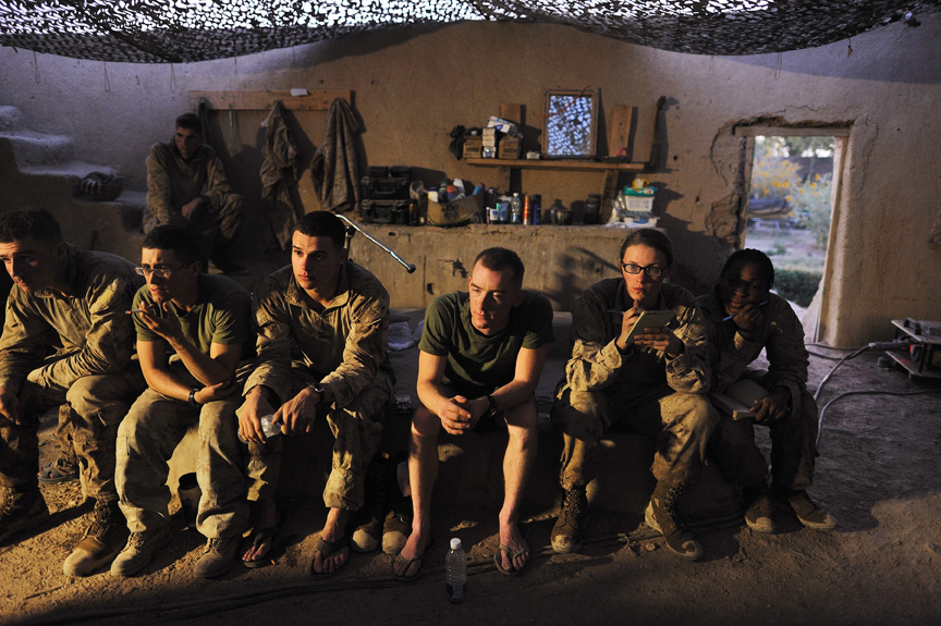 United States Marines, Lance Cpl. Stephanie Robertson, 20, second from right, and Cpl. Christina Oliver, 25, right, members of the Female Engagement Teams attached to Second Batallian, 6th Marine Regiment, attend a debrief with Fox Company after an operation to clear out Taliban from Sistani village in preparation for parlimentary elections in Southern Marja, Afghanistan, September 15, 2010.  Though the overall mission of the FET teams is to engage Afghan women, the female marines are increasingly exposed to small arms fire and improvised explosive attacks while on their patrols to access villages.
