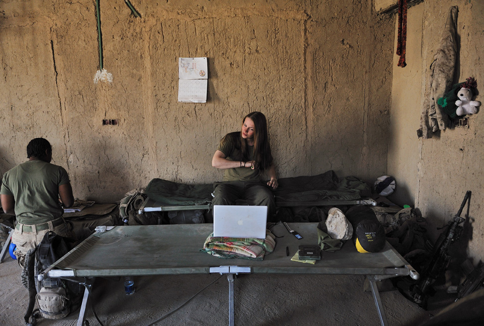 United States Marine, Lance Cpl. Stephanie Robertson, 20, a member of a Female Engagement Team attached to Second Batallian, 6th Marine Regiment, watches 'Finding Nemo' on her laptop at a forward operating base for Fox company in Southern Marja, Afghanistan, September 15, 2010.  Though the overall mission of the FET teams is to engage Afghan women, the female marines are increasingly exposed to small arms fire and improvised explosive attacks while on their patrols to access villages.