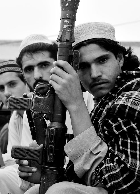 Pakistani Taliban fighters in Bar Kambar Khel, in the Pakistani tribal area near the border of Afghanistan, July 4, 2008.  The area is largely under the control of the group named the {quote}Prevention of Vice and Preservation of Virtue{quote} group{quote} which commands nearly 20% of the Tribal area. Since the start of the American-led war in Afghanistan in 2001, the Taliban has gradually infiltrated the areas surrounding Peshowar, making the tribal areas inaccessible, and Peshowar more tense.