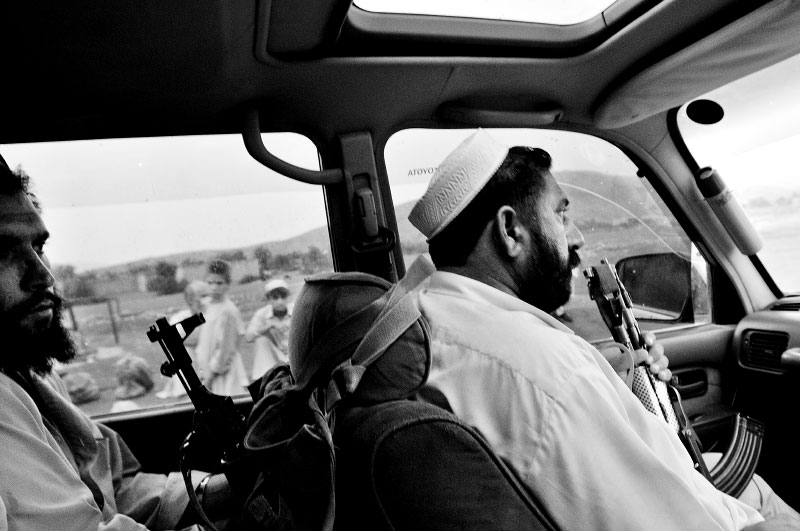 Ayub Khan, right, Taliban guard for second in command of the Pakistani Taliban group named the {quote}{quote}Prevention of Vice and Preservation of Virtue{quote} which commands nearly 20% of the Tribal area, drives through the Tribal area outside of Bar Kambar Khel, near the border of Afghanistan, July 4, 2008. Since the start of the American-led war in Afghanistan in 2001, the Taliban has gradually infiltrated the areas surrounding Peshowar, making the tribal areas inaccessible, and Peshowar more tense.