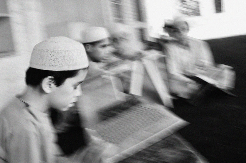 Young Afghan boys from Kabul study the koran at the Jammiah Ashrafiah Madrassa in Peshowar, in the North West Frontier Province of Pakistan, July 5, 2008.  Their parents are in Afghanistan, and they are living in the Madrassa. While Madrassas have traditionally been a place for young men to study the Koran in step with Islamic studies, it has also been a breeding ground for young men's hatred towards the West, and a place from which many initiate their Jihadist beliefs. Since the start of the American-led war in Afghanistan in 2001, the Taliban has gradually infiltrated the areas surrounding Peshowar, making the tribal areas inaccessible, and Peshowar more tense.