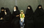 Iranian women wait on line to vote at a mosque in the second round of presidential elections in Tehran, Iran, on June 23, 2005. In the closest presidential race since the 1979 Islamic Revolution, Ahmadinejad and former Iran president, Akbar Hashemi Rafsanji, will face each other in an unprecedented run-off vote next week.