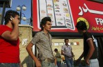 Young Iranian men hang out looking for girls in front of a mall in Tehran, Iran, July 1, 2005.  With the recent election of conservative Tehran Mayor as President-elect, Mahmoud Ahmadinejad, there is much speculation as to whether he will reverse the social freedoms many Iranians have gained in the last eight years under President Khatami.