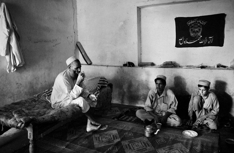 Pakistani and Afghan students study at the Al Jamiat ul Islamia Jamat Ishat Tauheed wal Sunnah madrassa in Peshowar, Pakistan, July 8, 2008. Madrassas in Pakistan have traditionally been the incubator for Jihadist thoughts, though each Madrassa has varying degrees of conservatism, and amount it promotes Jihad. The Salafi branch of Islam is the most conservative, and emphatically promotes it members to fight Jihad, while the Towheed and Deobandi (Taliban in Afghanistan study in Deobandi madrassas) both preach jihad, but let its followers decide to what degree they would like to carry it out. 'Go for Jihad in the way of Allah' is a verse from the Koran, and all Muslims in all Madrassas are taught this--though some emphasize it more than others.  Since the start of the American-led war in Afghanistan in 2001, the Taliban has gradually infiltrated the areas surrounding Peshowar, and many come into Peshowar from the tribal area, increasing tensions in Peshowar