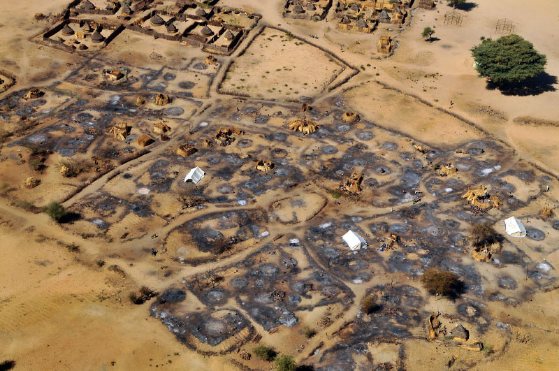 An overhead view of the remains of the burned-out village of Abu Sourouj, which was bombed on the 8 February by the Sudanese government and simultaneously attacked by armed men on camels, horseback and donkeys, otherwise known as Janjaweed, in West Darfur, Sudan, February 28, 2008.  The government spate of bombings was in response to an ambush two months prior by rebels from the Justice and Equality Movement, and subsequent intelligence that JEM members were living in these villages and using them as a base. After a period of relative quiet, there has been a great deal of renewed fighting between the Sudanese government with militias loyal to the government and rebel factions, namely JEM. Dozens of civilians in Silean, Sirba, and Abu Sourouj were killed in the attacks around February 8-9th,many others were injured, and a large percentage of each of the three villages was burned to the ground.