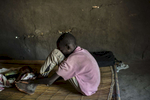 A South Sudanese boy who was the sole survivor of the 22-23 October 2015 incident in which government forces closed some 50 men in a shipping container for 36 hours until they suffocated is interviewed in a safe house in Leer, in Unity State, South Sudan, March 19, 2016.  When fighting raged throughout Leer in 2014 and 2015, most of the population fled, leaving civilians unable to harvest crops,and many struggling to find food. The city of Leer, once a bustling city and headquarters of opposition leader Riek Marchar, is now a ghost town reduced to rubble and the carcases of buildings. (Credit: Lynsey Addario for Time Magazine)
