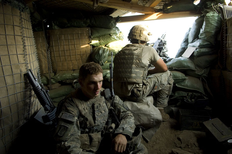 Lt. Matt Piosa of the 173rd Division, Battle Company, sits in a bunker at a new outpost following a week of heavy fighting to take the outpost from Anti-Coalition Members in the Korengal Valley. October 2007.