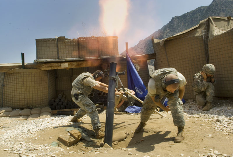 The mortar team fires mortars in response to a mortar attack from Anti-Coalition members on an American base in the Pesh River Valley in Kunar province. September 2007.