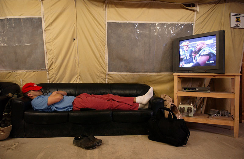 A United States Military surgeon sleeps while watching a football game at the Balad Hospital at the Balad Air Force base in Iraq. Hundreds of wounded soldiers have come through the military hospital for emergency treatment since the siege of Falujah began in early November.