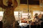 United States wounded soldiers are transported from the Contingency Air medical Staging Facility, or the CASF, where soldiers who are not in intensive care stay, via school bus to the plane headed out to Germany for further treatment. Since the fight for Fallujah began in early November, hundreds of injured soldiers have streamed through the balad hospital