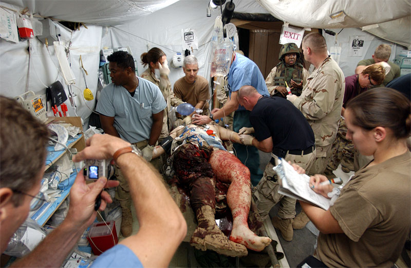United States Military surgeons treat a wounded soldier in the Emergency room of the Balad Hospital at the Balad Air Force base in Iraq. Hundreds of wounded soldiers have come through the military hospital for emergency treatment since the siege of Falujah began in early November.