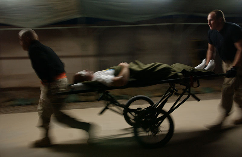 United States soldiers wheel in a wounded soldie from the helipad into the Balad Hospital at the Balad Air Force base in Iraq. Hundreds of wounded soldiers have come through the military hospital for emergency treatment since the siege of Falujah began in early November