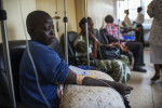 Breast Cancer patient Jessy Acen, 30, receives chemotherapy at the Cancer Institute attached to the Mulago Hospital, in Kampala, Uganda, July 22, 2013.  Jessy, who has two children living with relatives in the northern district of Gulu,  found a tumor in her breast in 2008, and eventually went to a medical center in Gulu for diagnosis. Her case was disregarded by doctors in Gulu, and after persisting, Jessy was finally sent to the Mulago Hospital in Kampala for treatment.  Like so many women in Uganda who don't seek medical care for diagnosis and treatment in the early stages of Cancer, or who are misdiagnosed by medical staff around the country, Jessy's cancer was advanced when she finally had a mastectomy.  Jessy sleeps at the hospital for several weeks while receiving chemotherapy because she could not afford the $10. bus fare back to Gulu.