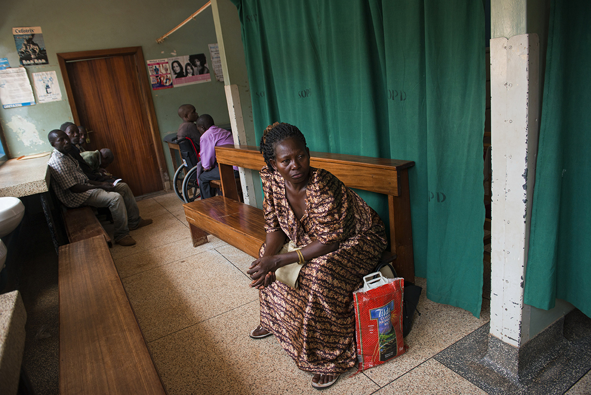 Ugandan woman Mary Namata awaits a team of American Oncologists to attend to her during a weekly screening for Breast Cancer at The Mulago Hospital in Kampala, Uganda, July 17, 2013.  A team of American doctors from the University of Washington visited and worked alongside Ugandan medical staff at the Cancer Institute and the Mulago Hospital--the primary two locations in all of Uganda for detection and treatment of Cance
