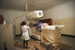 A Ugandan women receives radiation treatment for cervical cancer at the Mulago Hospital, in Kampala, Uganda, July 19, 2013.  While Uganda was able to get a handle on the AIDs epidemic through ARV drugs and assistance from the international community, the country still struggles with how to treat and diagnose an overwhelming number of Cancer patients across the country.  Thousands are currently being treated by only a handful of trained Oncologists in the entire country of Uganda; basic chemotherapy and Cancer medicines are often in short supply or unavailable, the radiation machine is outdated, in-patient beds are limited, and most Cancer patients can not afford transportation fare to reach diagnosis and treatment in Kampala from villages across the country.
