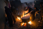 Syrian women prepare a meal for the funeral of a Free Syrian Army fighter who had been killed across the border in Aleppo, while his family members sought refuge in the Lebanese village of Saadnayel, in the Bekaa Valley, in Lebanon, January 17, 2013.  The United Nations estimates that the number of Syrian refugees currently in countries bordering Syria has risen to 600,000, with around 200,000 already registered in Lebanon