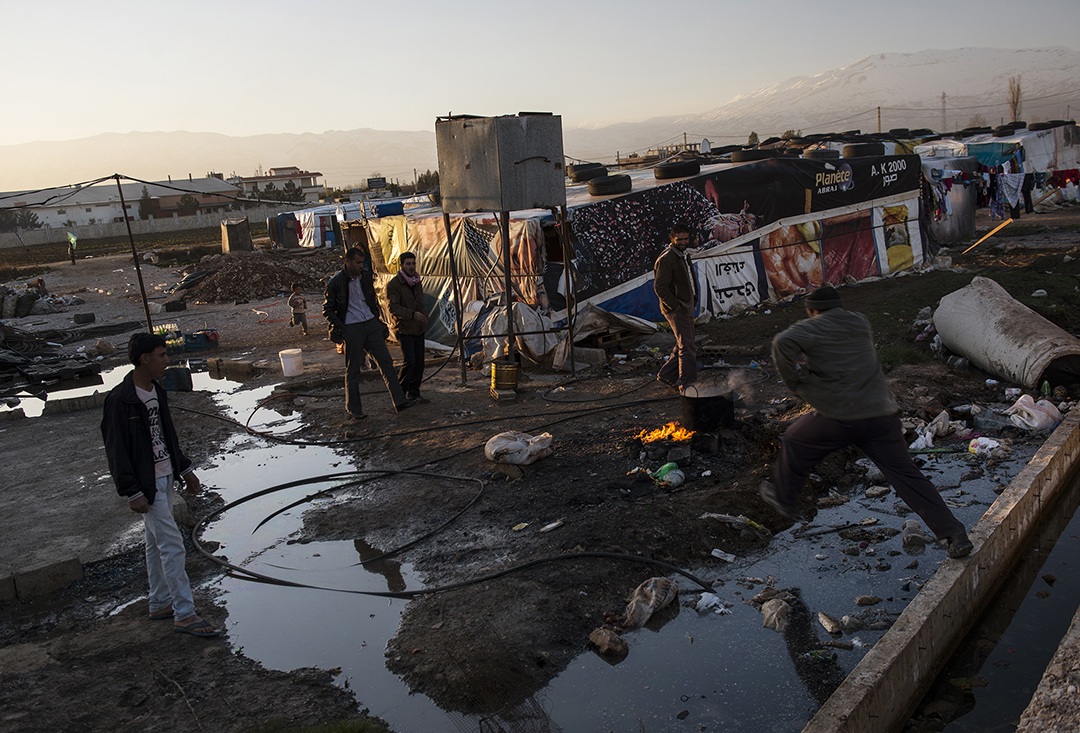 Syrian refugees live amidst mud and raw sewage in tents originally set up for seasonal workers near the Lebanese village of Majd al-Anjar, along the Syrian border in the Bekaa Valley, in Lebanon, January 19, 2013. Lebanon has roughly 200,000 Syrian refugees already registered with the United Nations High Commission of Refugees, and a presumed thousands of others awaiting registration.  The UNHCR estimates that the total number of Syrian refugees is over 600,000 in countries bordering Syria.   Lebanon, unlike Turkey and Jordan, has avoided setting up typical tent camps for refugees, and so refugees are forced to live underneath commercial buildings, in m