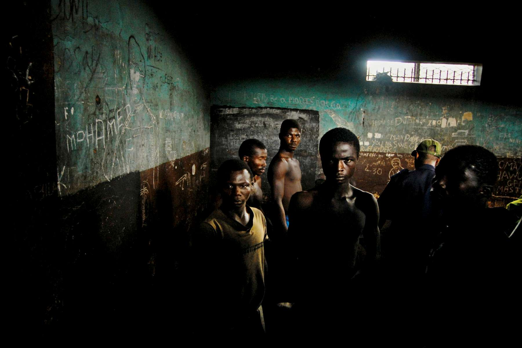 Prisoners wait in the remand section of the Pademba Road Prison in Freetown,Sierra Leone, November 2006.