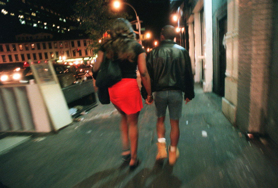Aurora and her ex-boyfriend, Mohammed, walk through the streets in the West Village on Sunday morning, May 16, 1999. Though they have been broken up for some time, Mohammed often visits Aurora while she works the stroll in the West Village to watch her back and make sure she is alright. (Credit: Lynsey Addario)