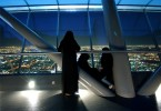 Saudi women look out onto Riyadh City from atop the Kingdom Tower, the tallest building in Saudi Arabia, in Riyadh, Saudi Arabia, December 2003.  Due to the strict laws and norms in Saudi culture segregating men and women, a public display of affection between young couples is very rare.