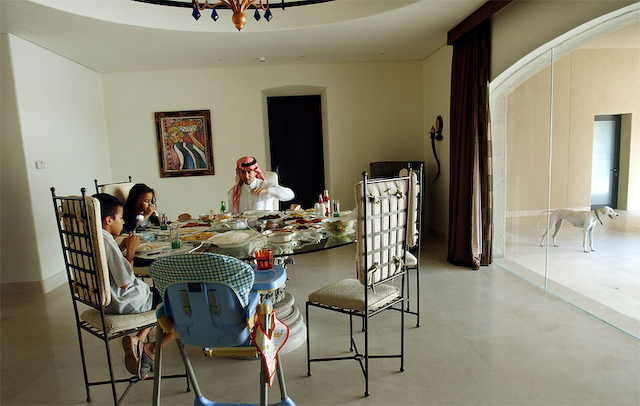 Prince Mohammad bin Faisal eats lunch at home with his children in Riyadh, Saudi Arabia, 2004.