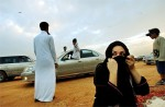 Saudi young men and women hang out in the desert outside of Riyadh, Saudi Arabia, 2004.