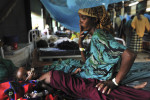 Fatuma Mohammed, who is roughly 8 months pregnant, sits with her severely malnourished daughter the morning after one of her daughters died in the intensive care section of the MSF hospital in Dagahaley camp, near the Kenyan border with Somalia, August 20, 2011.  Fatuma, like thousands of other Somali refugees, fled a prolonged drought in Somalia about two months ago; the daughter in this image died the following day.  Dadaab, with roughly 400,000 refugees, Dadaab is the largest refugee camp in the world. The camp is grossly over capacity, and the refugees experience an ever-shrinking access to essential services such as water, sanitation, food and shelter, also because they have been sharing their rations with the new arrivals. At the current pace of arrival MSF estimates that the camp's population will total 500'000 before the end of 2011, and living conditions are only expected to deteriorate further. Without a long-term solution in sight, Médecins Sans Frontières (MSF) is deeply concerned about the fate of the hundreds of thousands of people who seek refuge in Kenya due to the ongoing conflict in Somalia combined with a looming nutritional crisis after several years of droughThe horn of Africa is suffering one of the worst droughts in years, displacing thousands, and killing others through severe malnutrition.The horn of Africa is suffering one of the worst droughts in years, displacing thousands, and killing others through severe malnutrition. In response to the increasing severity of the situation MSF is operating an emergency nutrition intervention in Turkana.