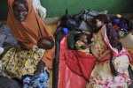 Somali mothers wit with their children being treated for severe malnutrition in the Benadir Hospital in Mogadishu, Somalia, August 29, 2011.  Medina and her family arrived from Dinsor to Mogadishu a few months prior, like thousands of Somalis who have traveled to the capital city of Mogadishu to escape extreme drought conditions in their villages--an estimated 1.7 million people have become drought displaced, according to an UNOCHA report. The horn of Africa is suffering one of the worst droughts in years, displacing thousands, and killing others through severe malnutrition, measles, and diarrhea.  The UN estimates roughly 29,000 children have already died because of drought-related illnesses, but Islamic Relief, and organization that has people on the ground in Somalia, estimate that number is much higher.
