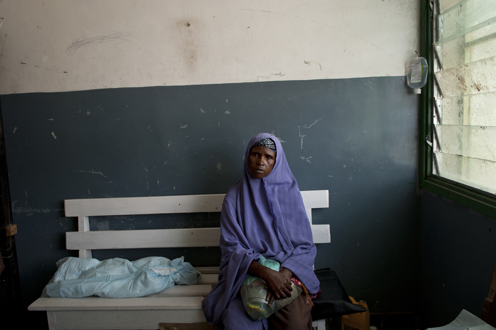 A woman waits in a Somali Hospital. Thousands of Somalis have traveled to neighboring countries and to the capital city of Mogadishu to escape extreme drought conditions in their villages--an estimated 1.7 million people have become drought displaced, and tens of thousands have perished. The horn of Africa is suffering one of the worst droughts in years, displacing thousands, and killing others through severe malnutrition, measles, and diarrhea.