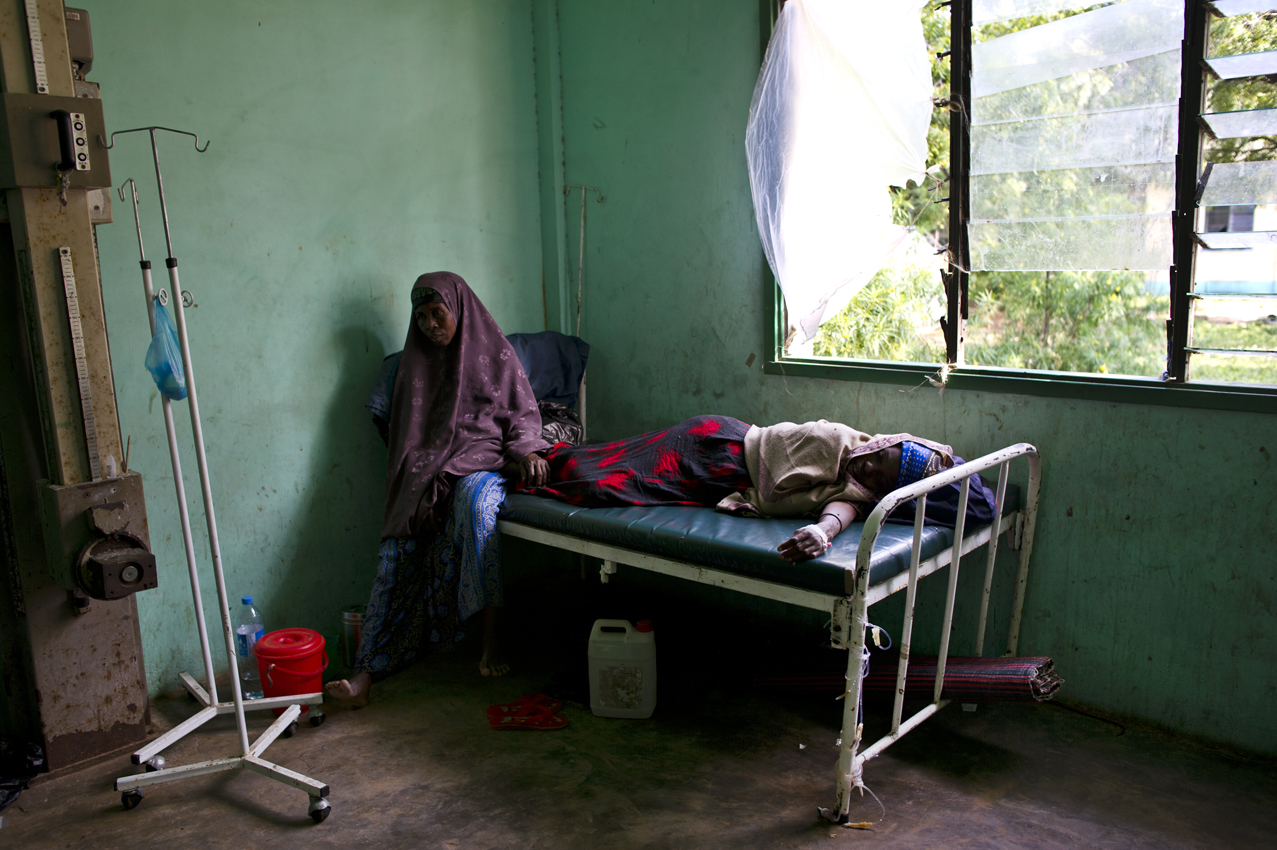Somalis suffer from diarrhea in the Benadir Hospital in Mogadishu, Somalia, August 26, 2011.  The hospital is overflowing with people sleeping on the floors throughout most wards. Thousands of Somalis have traveled to neighboring countries and to the capital city of Mogadishu to escape extreme drought conditions in their villages--an estimated 1.7 million people have become drought displaced, according to an UNOCHA report. The horn of Africa is suffering one of the worst droughts in years, displacing thousands, and killing others through severe malnutrition, measles, and diarrhea.