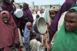Somali's line up for food distribution on August 25, 2011.  Thousands of Somalis have traveled to neighboring countries and to the capital city of Mogadishu to escape extreme drought conditions in their villages--an estimated 1.7 million people have become drought displaced, according to an UNOCHA report. The horn of Africa is suffering one of the worst droughts in years, displacing thousands, and killing others through severe malnutrition, measles, and diarrhea.