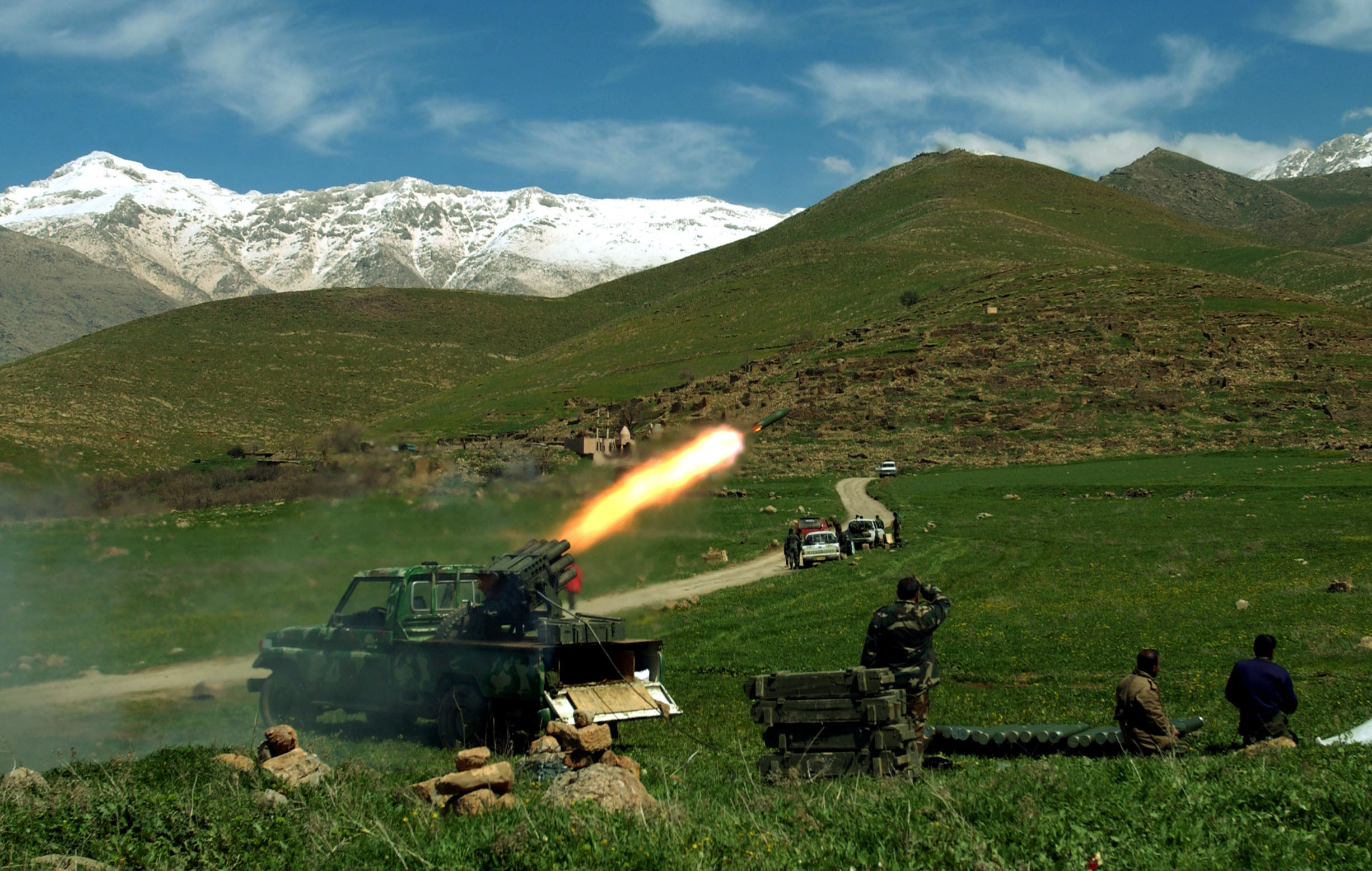 Kurdish Peshmerga fire rockets at Ansar territory whileduring a US-lead war in coalition with Kurdish fighters against the fundamentalist group qwith alleged ties to Al Quaeda near Halabja,  Northern Iraq, March 30, 2003.  The United States is leading a war on several fronts throughout Iraq and Northern Iraq both in the name of the War on Terrorism and to overthrow Iraqi ruler Saddam Hussain.